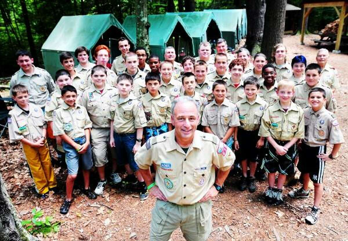 Scoutmaster Bill Earley (foreground center) is photographed with Boy Scout Troop 610 of Hamden at Camp Sequassen in New Hartford, Connecticut, on 7/5/2013. Arnold Gold / Register