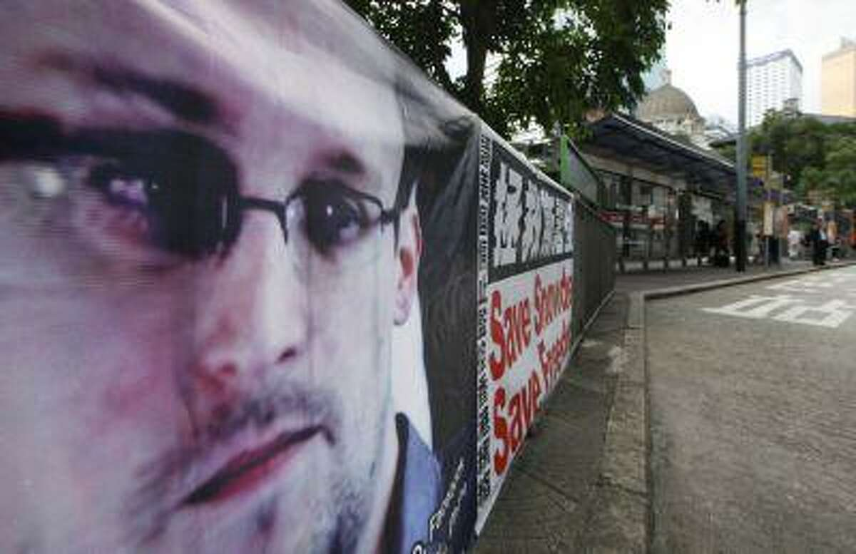 A banner supporting Edward Snowden, a former CIA employee who leaked top-secret documents about sweeping U.S. surveillance programs, is displayed at Central, Hong Kong's business district, Thursday, June 20, 2013.