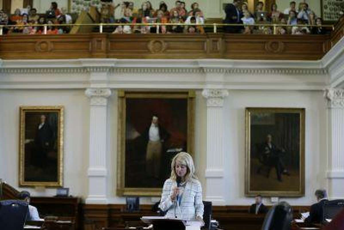 In this June 25, 2013 file photo, Sen. Wendy Davis, D-Fort Worth, is speeks during her filibuster of an abortion bill, Tuesday, June 25, 2013, in Austin, Texas. The bill will get another chance next week now that the Gov. Rick Perry has called another special legislative session. (AP Photo/Eric Gay)