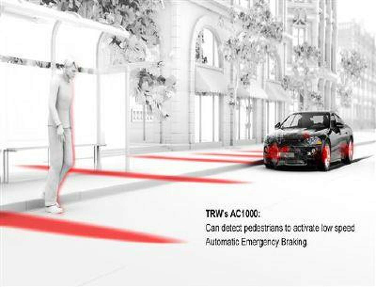 This photo provided by TRW Automotive shows a radar and camera systems that warn you, with beeping sounds, of a possible front-end crash is highlighted. The systems are the outgrowth of adaptive cruise control, which came out 15 years ago and helps keep cars a safe distance from vehicles in front of them. (AP Photo/TRW Automotive)
