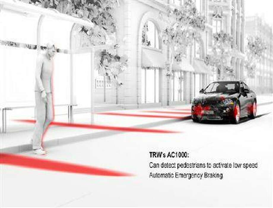 This photo provided by TRW Automotive shows a radar and camera systems that warn you, with beeping sounds, of a possible front-end crash is highlighted. The systems are the outgrowth of adaptive cruise control, which came out 15 years ago and helps keep cars a safe distance from vehicles in front of them. (AP Photo/TRW Automotive) Photo: AP / TRW Automotive