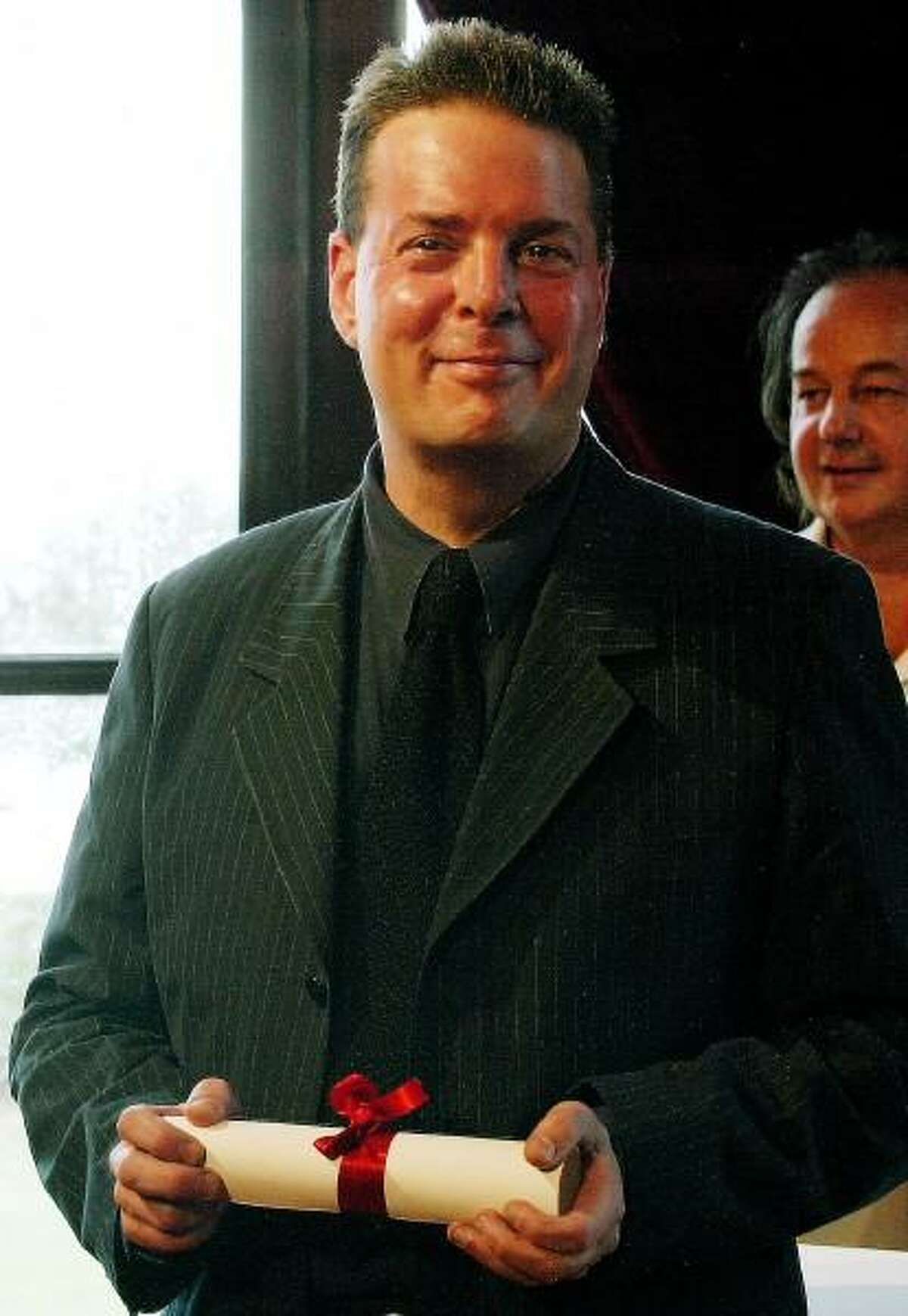 """Franck Prevel - AP file photo: American writer Douglas Kennedy was presented with the Literary Award of the American Film Festival of Deauville for his book """"Losing it"""" in Deauville, Normandy, in 2003. The award is presented to a French or American writer who talks about America with humor, lightness or gravity."""