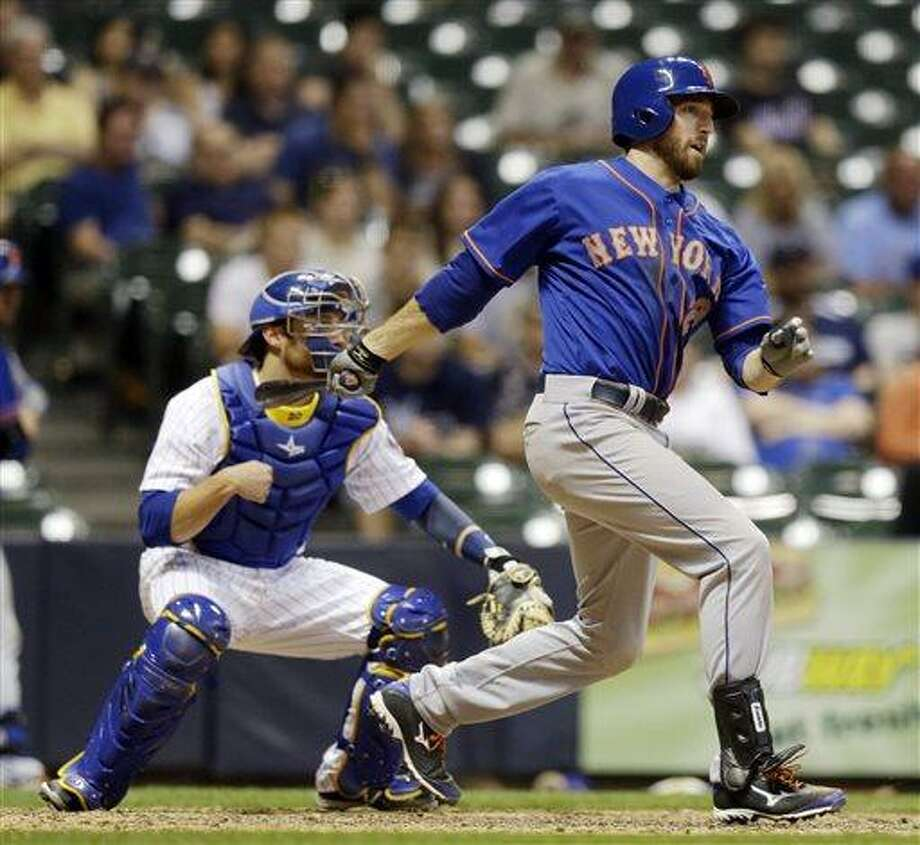 New York Mets' Ike Davis hits an RBI single during the ninth inning of a baseball game against the Milwaukee Brewers Friday, July 5, 2013, in Milwaukee. (AP Photo/Morry Gash) Photo: AP / AP