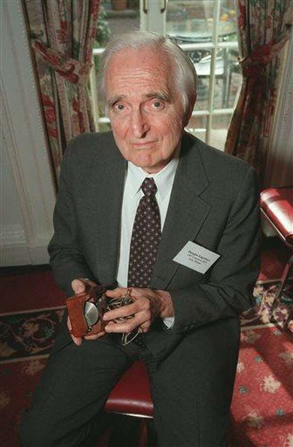 In this April 9, 1997 file photo, Doug Engelbart, inventor of the computer mouse and winner of the half-million dollar 1997 Lemelson-MIT prize, poses with the computer mouse he designed, in New York. Engelbart has died at the age of 88. The cause of death wasn't immediately known. (AP Photo/Michael Schmelling, File) Photo: AP / AP