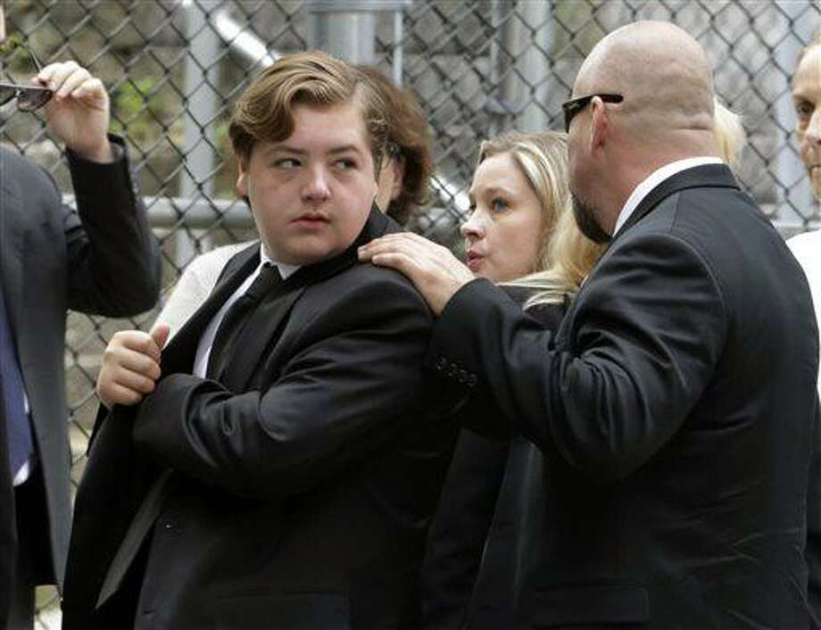 """In this Thursday, June 27, 2013 file photo, Michael Gandolfini, left, son of James Gandolfini, arrives for the funeral service of his father, star of """"The Sopranos,"""" in New York's the Cathedral Church of Saint John the Divine. James Gandolfini left the bulk of his estimated $70 million estate to his 13-year-old son, Michael, and infant daughter Liliana. (AP Photo/Richard Drew, File) Photo: AP / AP"""