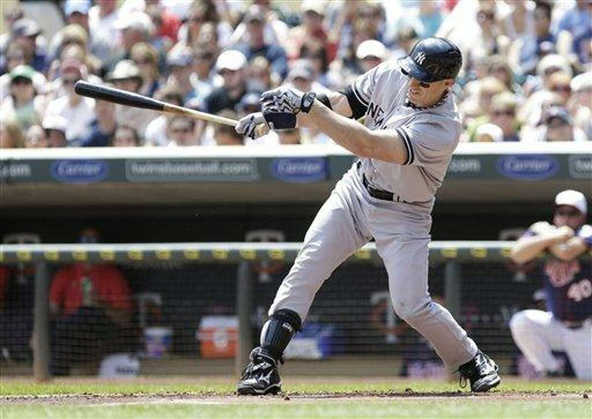 New York Yankees' Travis Hafner doubles off Minnesota Twins pitcher Kyle Gibson in the first inning of a baseball game, Thursday, July 4, 2013 in Minneapolis. (AP Photo/Jim Mone)