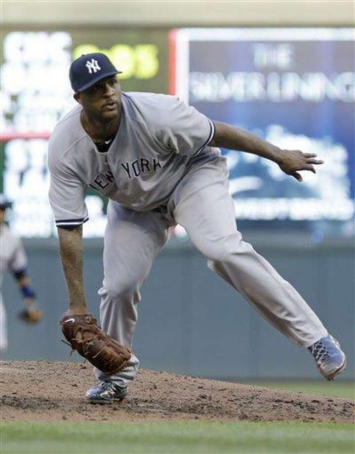 New York Yankees pitcher CC Sabathia pitches in the third inning of a baseball game against the Minnesota Twins, Wednesday, July 3, 2013 in Minneapolis. The Yankees won 3-2. (AP Photo/Jim Mone) Photo: AP / AP