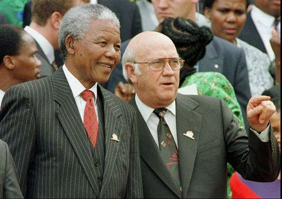 FILE - In this Wednesday May 8, 1996 file photo, South African President Nelson Mandela, left, and Deputy President F.W. de Klerk chat outside Parliament after the approval of South Africa's new constitution. de Klerk, the last leader of the apartheid era and a co-recipient of the 1993 Nobel Peace Prize with Nelson Mandela, has suffered dizziness and will be fitted with a pacemaker, Tuesday June 2, 2013, to help his heart function.  (AP Photo/POOL) Photo: AP / POOL