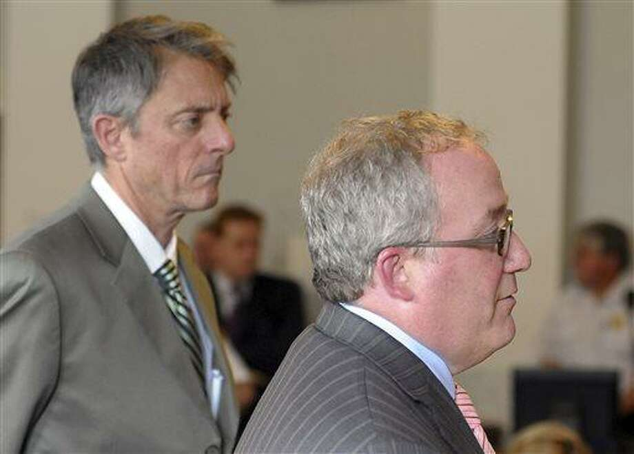 Bristol County District Attorney Sam Sutter, left, stands as Assistant District Attorney Patrick Bomberg speaks during the arraignment of Carlos Ortiz, Friday, June 28, 2013 in Attleboro, Mass. Ortiz was arrested Wednesday in Bristol, Conn., in connection with the murder case against former New England Patriots tight end Aaron Hernandez , now charged in the murder of Odin Lloyd.   (AP Photo/The Sun Chronicle, Mark Stockwell, Pool) Photo: AP / Pool, The Sun Chronicle