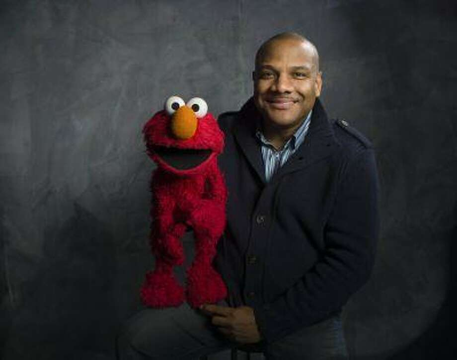 """Elmo and puppeteer Kevin Clash of the film """"Being Elmo"""" pose for a portrait in the Fender Music Lodge during the 2011 Sundance Film Festival in Park City, Utah. Photo: ASSOCIATED PRESS / AP2011"""