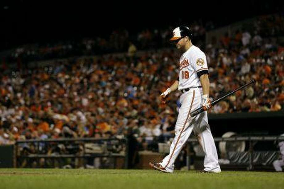 Baltimore Orioles' Chris Davis walks out to home plate for an at-bat during a baseball game against the Cleveland Indians, Tuesday, June 25, 2013, in Baltimore. Photo: AP / AP