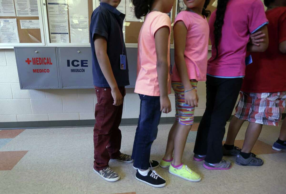 Detained immigrant children line up in the cafeteria at the Karnes County Residential Center, a temporary home for immigrant women and children detained at the border, Wednesday, Sept. 10, 2014, in Karnes City, Texas. Federal authorities want to build a similar immigration lockup facility for families in Dilley, Texas, south of San Antonio amid an unprecedented surge in the number of youngsters pouring across the U.S. border, a federal official said Thursday. (AP Photo/Eric Gay)