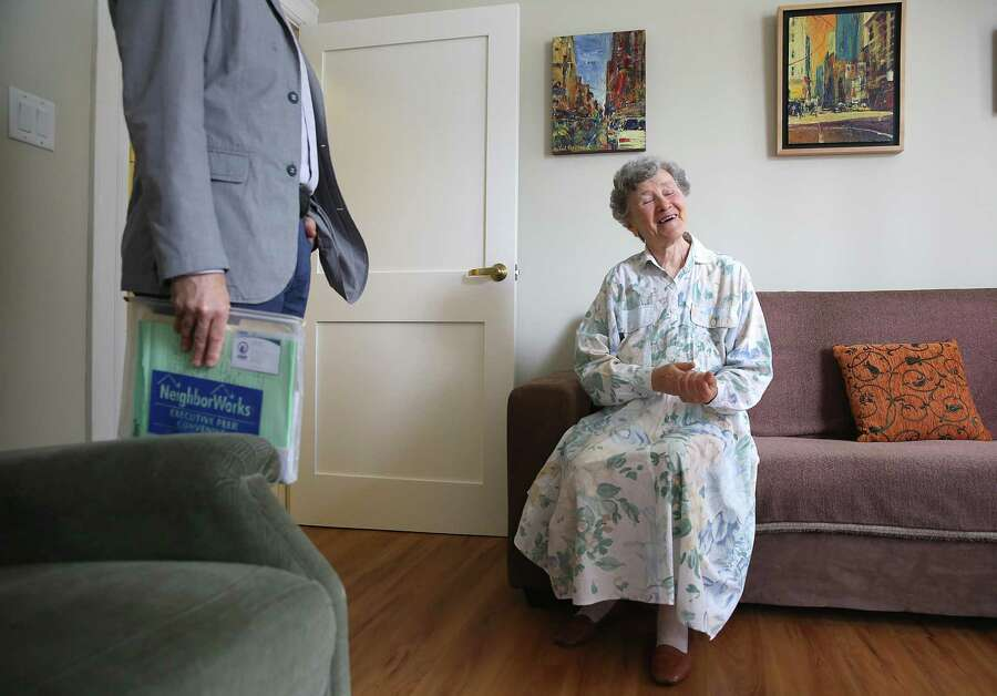 CEO Donald S. Falk of Tenderloin Neighborhood Development, left, speaks with resident Arsina Rabichev, 90 years old at her home in San Francisco on Monday, August 7, 2017. Ms. Rabichev has been living in the building for 37 years. Photo: Liz Hafalia / The Chronicle / online_yes