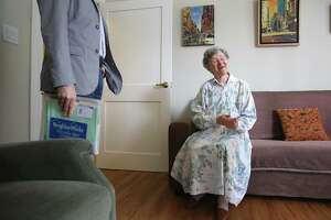 CEO Donald S. Falk of Tenderloin Neighborhood Development, left, speaks with resident Arsina Rabichev, 90 years old at her home in San Francisco on Monday, August 7, 2017. Ms. Rabichev has been living in the building for 37 years.