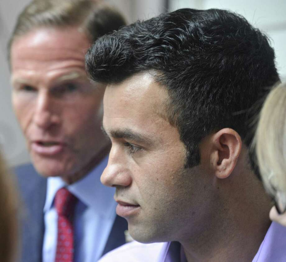 Joel Colindrés listens to Sen. Richard Blumenthal, who backed his effort to avoid deportation, during a press conference at his New Fairfield home on Aug. 7. Photo: H John Voorhees III / Hearst Connecticut Media / The News-Times