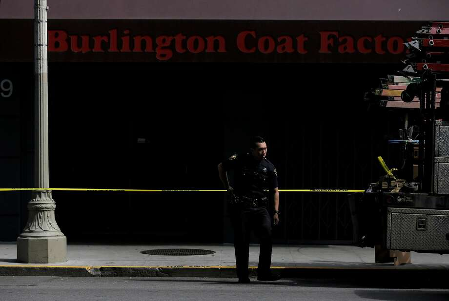 A police officer works the scene of a shooting at Burlington Coat Factory at Fifth and Howard in San Francisco on Tuesday, August 15, 2017. Photo: Guy Wathen, The Chronicle
