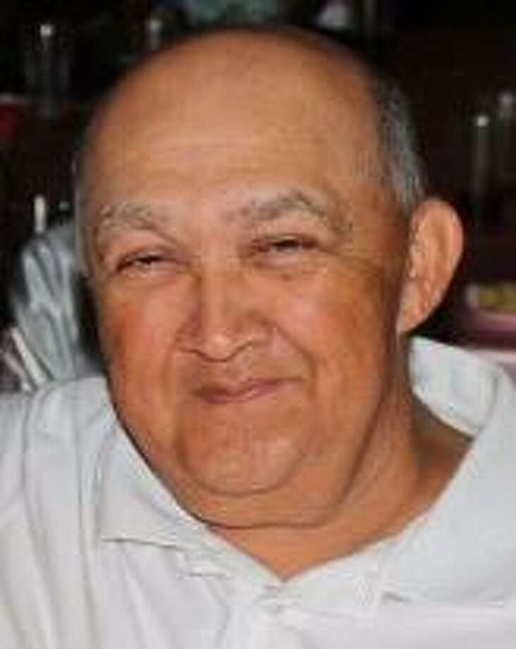 """Michael H. Olivarez was known as """"Coach Mike"""" to the numerous softball players he coached over a period of almost 20 years. Photo: Courtesy Photo"""