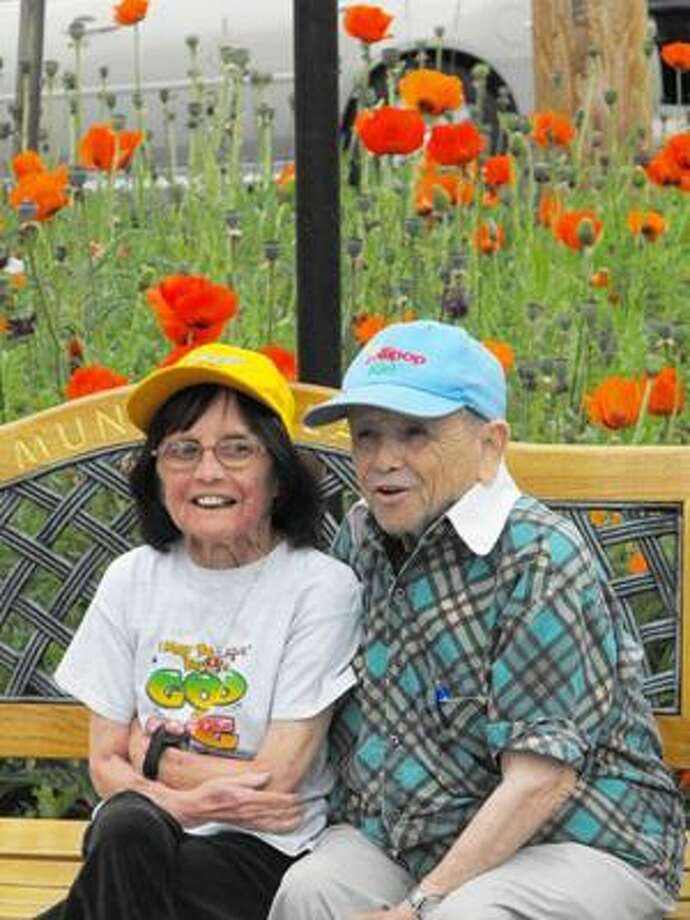 SUBMITTED PHOTO Elizabeth Maren and her husband, Jerry, sit on a bench in Chittenango.