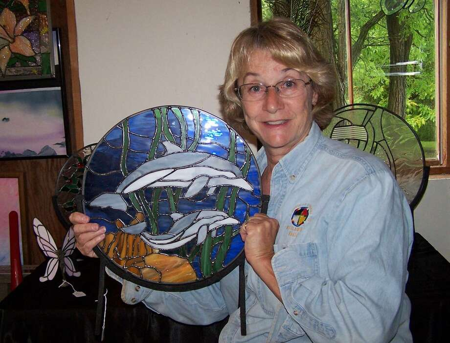 Submitted Photo Mary Beth Hewitt poses with her glasswork.