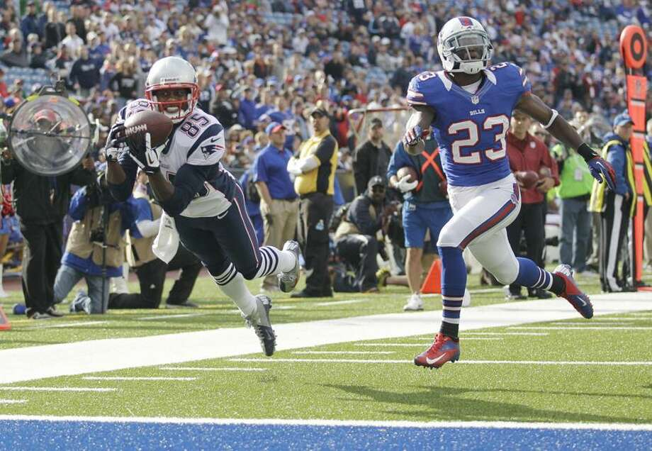 New England Patriots' Brandon Lloyd (85) makes a touchdown catch next to Buffalo Bills' Aaron Williams (23) during the second half of an NFL football game in Orchard Park, N.Y., Sunday, Sept. 30, 2012. (AP Photo/Gary Wiepert) Photo: AP / AP2012