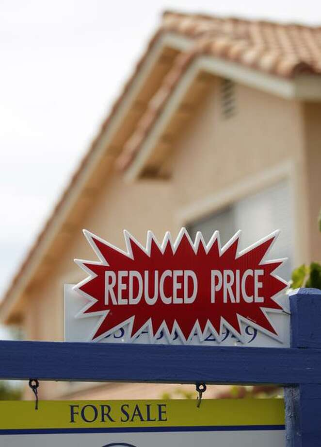 A house for sale advertises a reduced price Tuesday in San Diego. Home prices fell nationwide for the eighth straight month, according to the Standard & Poor's Case-Shiller 20-city index released Tuesday. Associated Press Photo: AP / AP