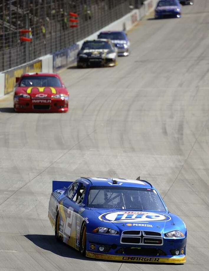 Brad Keselowski, front, competes during a NASCAR Sprint Cup Series auto race, Sunday, Sept. 30, 2012, at Dover International Speedway in Dover, Del. Keselowski won the race. (AP Photo/Nick Wass) Photo: AP / FR67404 AP