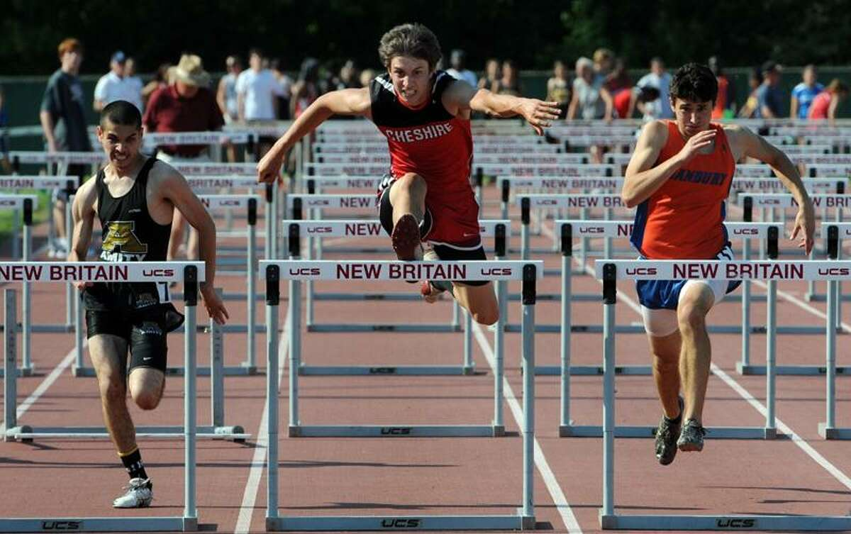 Cheshire's Eric Zdanowski center won the hurdles, Amity's Jesse Sanchez, left, came in third at Class LL track championships at Willowbrook Park, New Britain. Photo by Mara Lavitt/New Haven Register 5/31/11