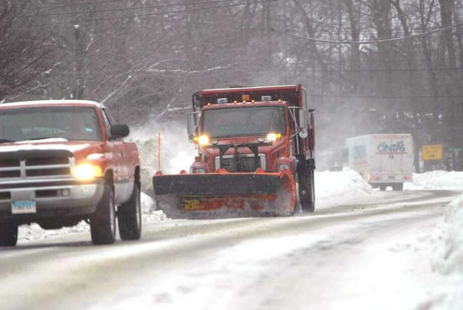 Town of Branford Dept. of Public Works snow plow truck keeps the road clear of snow on Pine Orchard Road and Damascus Road early Tuesday 2/1/11. Photo by Peter Hvizdak / New Haven Register
