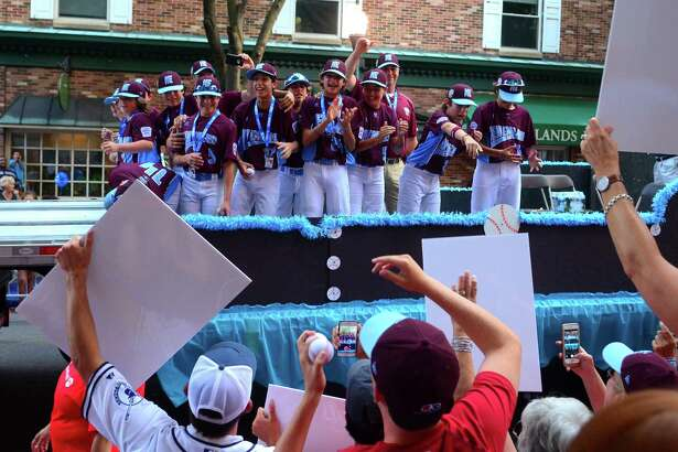 Members of the Fairfield American Little League team take part in the 13th Annual Grand Slam Parade in downtown Williamsport, Pa., on Wednesday.  Teams from all over the United States and around the world converge on Williamsport to compete in the Little League World Series. Fairfield American advanced to the LLWS after defeating Maine in Bristol, Conn. in the New England Regional Tournament.