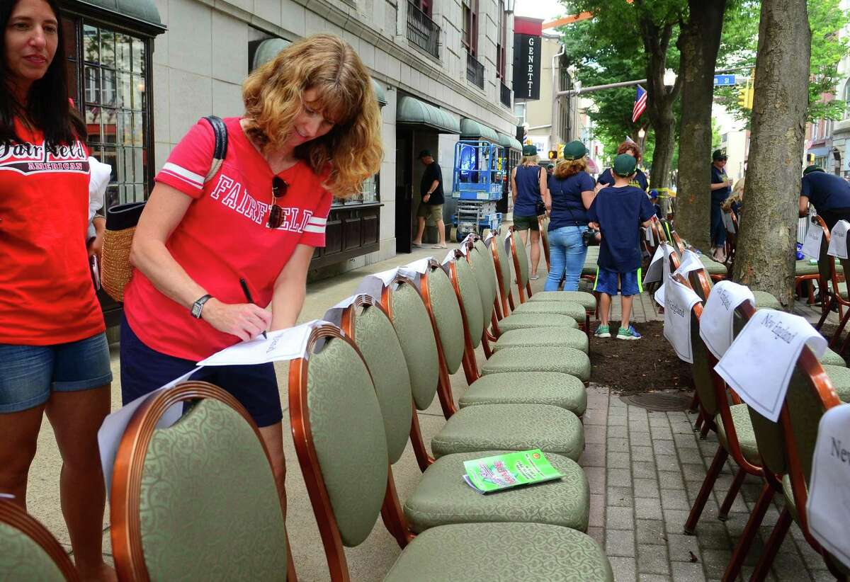 Dina Kalagher puts her name on a chair outside Genetti Hotel to save a spot before the start of the 13th Annual Grand Slam Parade in downtown Williamsport, Penn., on Wednesday Aug. 16, 2017. Teams from all over the United States and around the world converge on Williamsport to compete in the Little League World Series. Fairfield American advanced to the LLWS after defeating Maine in Bristol, Conn. in the New England Regional Tournament.