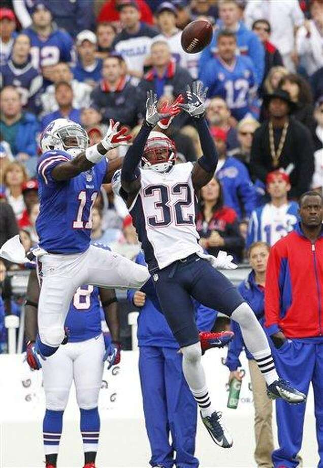 New England Patriots' Devin McCourty (32) intercepts a pass intended for Buffalo Bills' T. J. Graham (11) during the first half of an NFL football game in Orchard Park, N.Y., Sunday, Sept. 30, 2012. (AP Photo/Bill Wippert) Photo: ASSOCIATED PRESS / AP2012