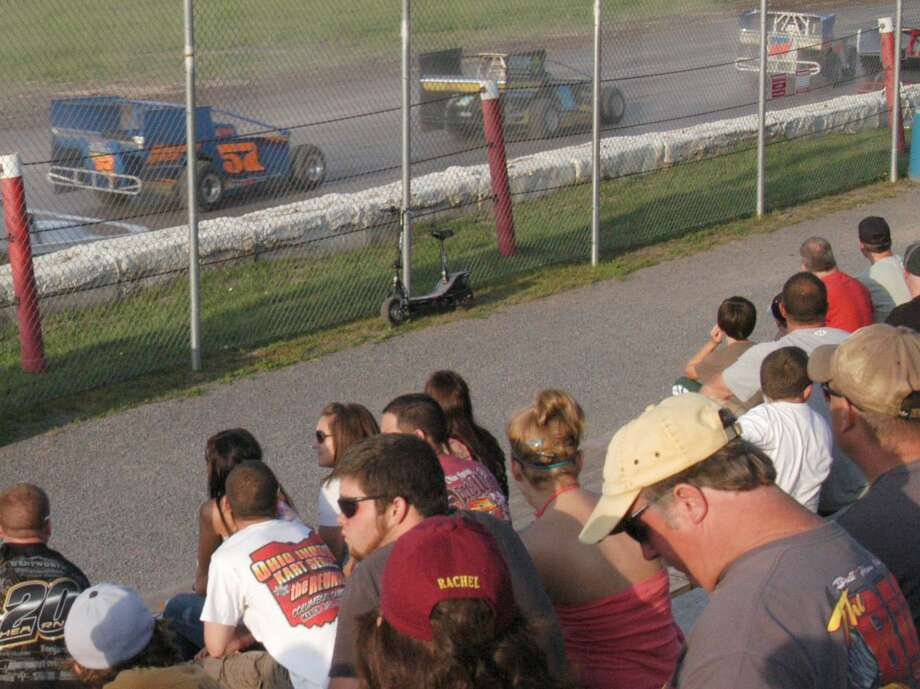 Dispatch Staff Photo by DAVID M. JOHNSON Fans at Utica-Rome Speedway watch a race during opening weekend of the track's 50th anniversary season Monday, May 30, 2011 in Vernon.