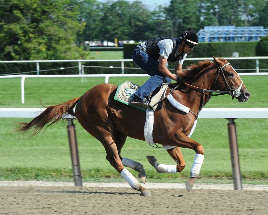In this image provided by the New York Racing Association (NYRA), Kentucky Derby and Preakness Stakes winner IÕll Have Another, ridden by exercise rider Jonny Garcia, gallops at Belmont Park, Thursday, May 31, 2012 in Elmont, N.Y. Trainer Doug O'Neill says a loose horse nearly slammed into the Triple Crown hopeful I'll during training Thursday at Belmont Park.(AP Photo/NYRA) Photo: AP / AP2012