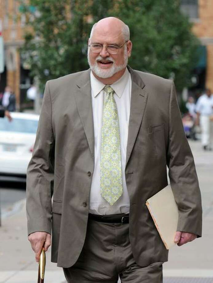 Dr. H. Wayne Carver II, state chief medical examiner, on his way into court for the Komisarjevsky trial in New Haven Wednesday. Mara Lavitt/Register