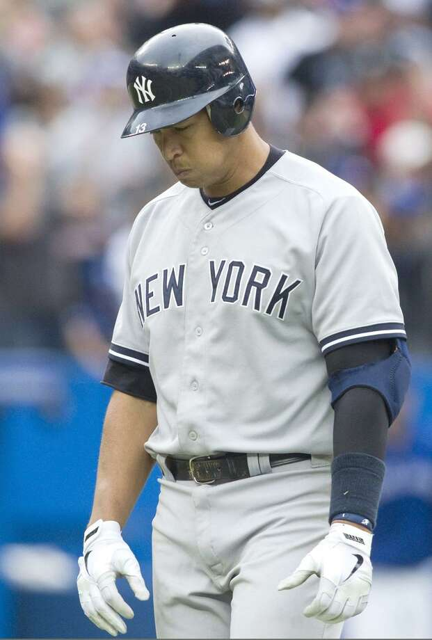 New York Yankees' Alex Rodriguez reacts after he flied out to center during the ninth inning of a baseball game against the Toronto Blue Jays in Toronto on Saturday, Sept. 29, 2012. (AP Photo/The Canadian Press, Chris Young) Photo: AP / CP