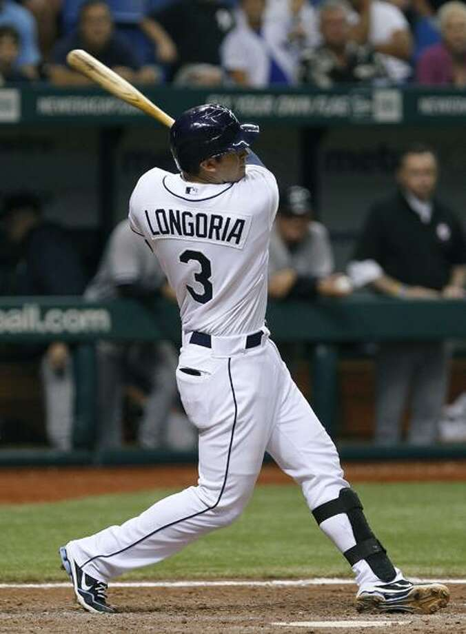 Tampa Bay Rays' Evan Longoria follows the flight of his eighth-inning, three-run home off New York Yankees relief pitcher Luis Ayala during a baseball game on Wednesday, Sept. 28, 2011, in St. Petersburg, Fla. (AP Photo/Chris O'Meara) Photo: AP / AP