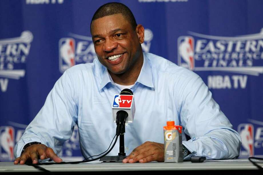 Boston Celtics head coach Doc Rivers speaks at a post game news conference after Game 2 in their NBA basketball Eastern Conference finals playoffs series against the Miami Heat, Wednesday, May 30, 2012, in Miami. (AP Photo/Wilfredo Lee) Photo: AP / AP