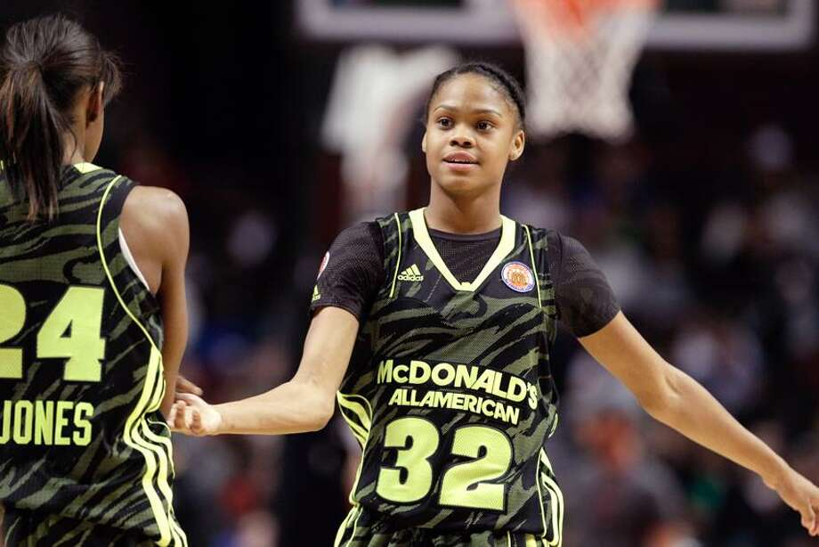 McDonald's West All-American Moriah Jefferson (32) shakes hands with Jordan Jones (24) during the second half of the McDonald's All-American girl's basketball game Wednesday, March 28, 2012, in Chicago. The East won 79-78. (AP Photo/Nam Y. Huh) Photo: AP / AP2012