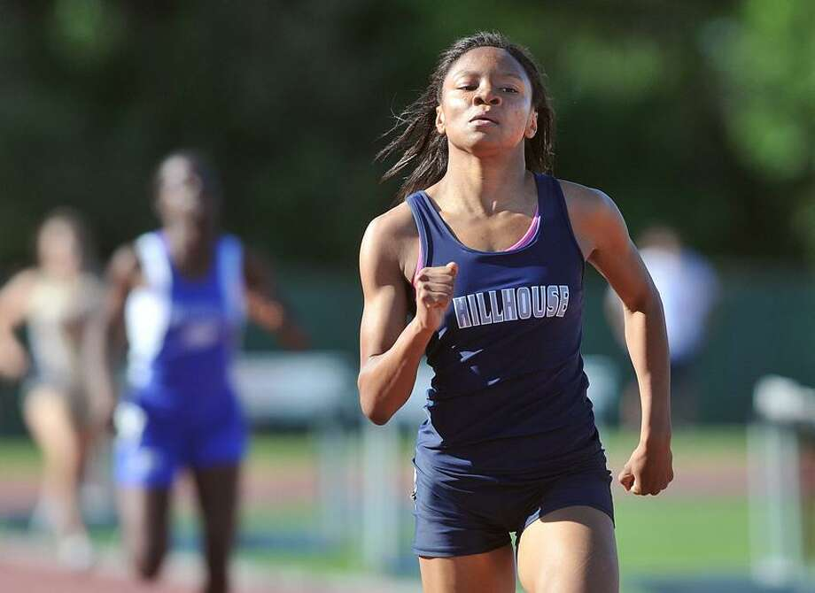 New Britain-- Action from the Class MM State Championship track meet held at Willow Brook Park in New Britain. Hillhouse's Precious Holmes on her way to a meet record and a first place in the 200-meter.  Peter Casolino/New Haven Register 05/31/12