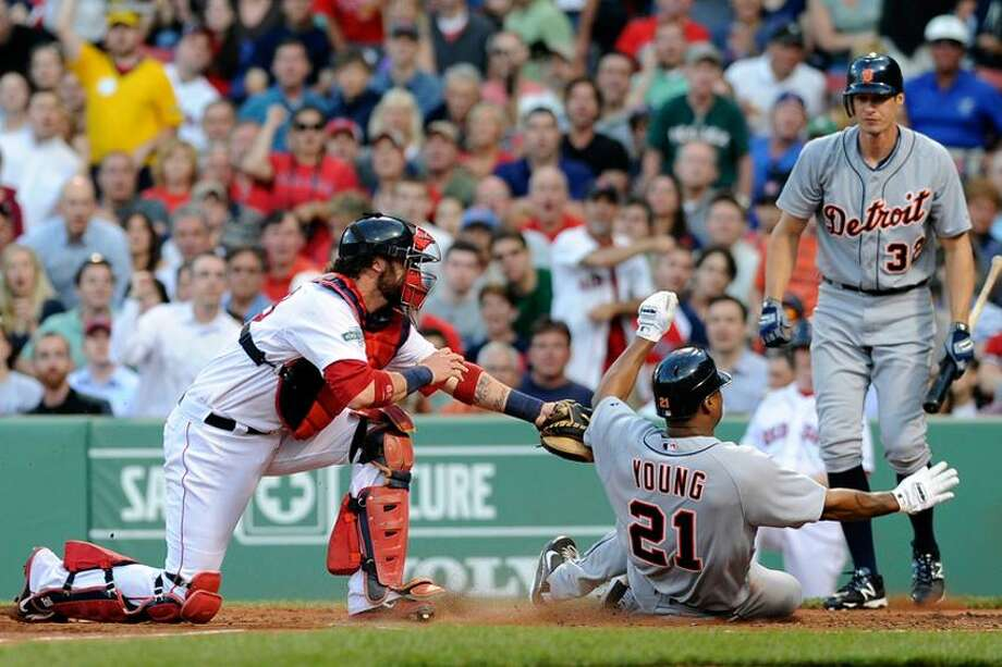 May 31, 2012; Boston, MA, USA; Detroit Tigers designated hitter Delmon Young (21) is tagged out by Boston Red Sox catcher Jarrod Saltalamacchia (39) during the second inning at Fenway Park. Mandatory Credit: Bob DeChiara-US PRESSWIRE Photo: US PRESSWIRE / Bob DeChiara