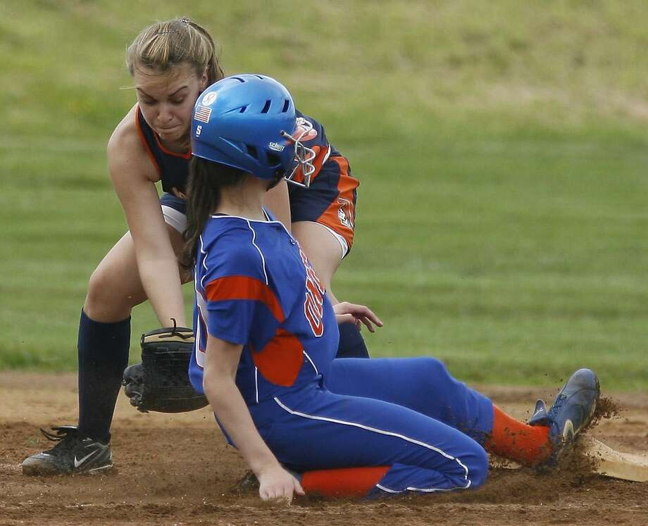 Dispatch Staff Photo by JOHN HAEGER Oneida's Mary Sheridan (10) is tagged out trying to steal  second base by ES-M's Kiersten Albertson in the bottom of the third inning of their Class A quarterfinal game on Saturday, May 28, 2011 in Oneida. ES-M won 2-0.