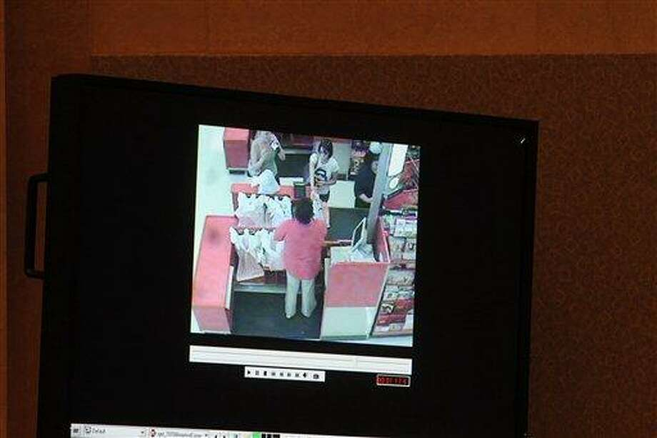 Casey Anthony is seen shopping in a detail of a surveillance video shown as evidence in the Casey Anthony trial is shown on a monitor at the Orange County Courthouse, Friday, May 27, 2011 in Orlando, Fla. The video is one of a series from retail stores that show Anthony shopping during the time period when her daughter Caylee was missing. Anthony has pleaded not guilty to first-degree murder of her daughter, 2-year-old Caylee Anthony in the summer of 2008. If convicted, she could be sentenced to death. (AP Photo/Red Huber, Pool) Photo: AP / Pool The Orlando Sentinel