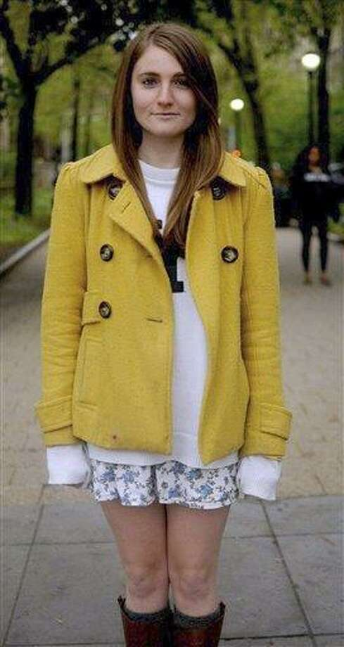 """This undated photo released by the Keegan family shows Marina Keegan, of Wayland, Mass., on the Yale University campus in New Haven, Conn. Marina, who graduated from Yale less than a week earlier, died at the scene of an automobile crash in Dennis, Mass., Saturday, May 26, 2012. Her writing had been published in The New York Times, and she had accepted a job at The New Yorker. Her final Yale Daily News column was widely shared on social media, where she had implored her classmates to """"make something happen to this world."""" (AP Photo/Keegan Family) Photo: AP / Keegan Family"""