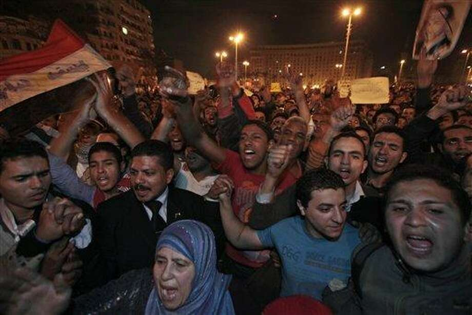 Protesters chant slogans during a demonstration in Tahrir square in downtown Cairo, Egypt, Sunday, Jan. 30, 2011. (AP Photo/Lefteris Pitarakis) Photo: AP / AP