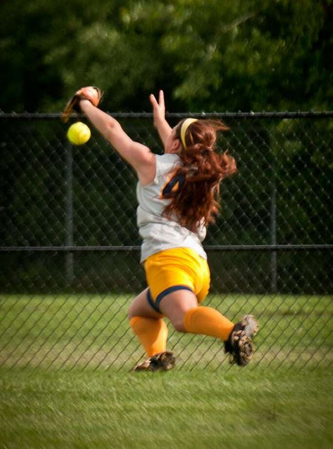 East Haven's Jenna Gaudioso can't make a catch at the fence in the third inning. Seymour tied the score 2-2, and went on to win in a Class M second-round tournament game.   Melanie Stengel/Register