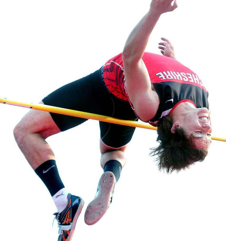 Jake Scinto of Cheshire clears 6 feet, 10 inches in the high jump to win the event in the CIAC Class LL Track Championship in Manchester. Photo by Arnold Gold/New Haven Register