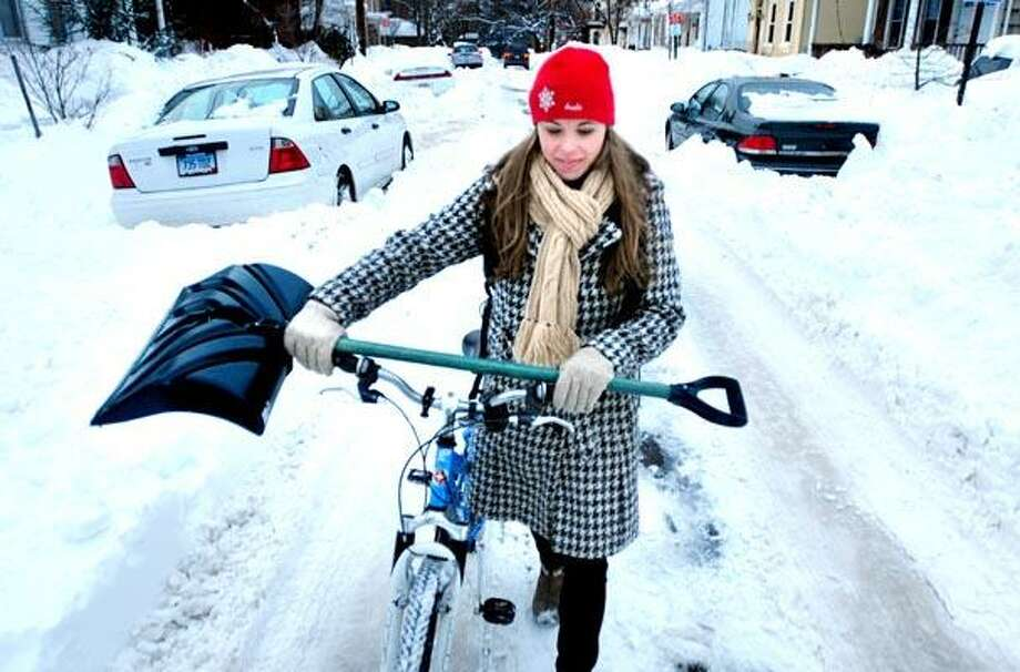 Kirsten Gilbert carries a snow shovel up Clark St. in New Haven so she could shovel out her car on 1/28/2011.Photo by Arnold Gold/New Haven Register      AG0401C