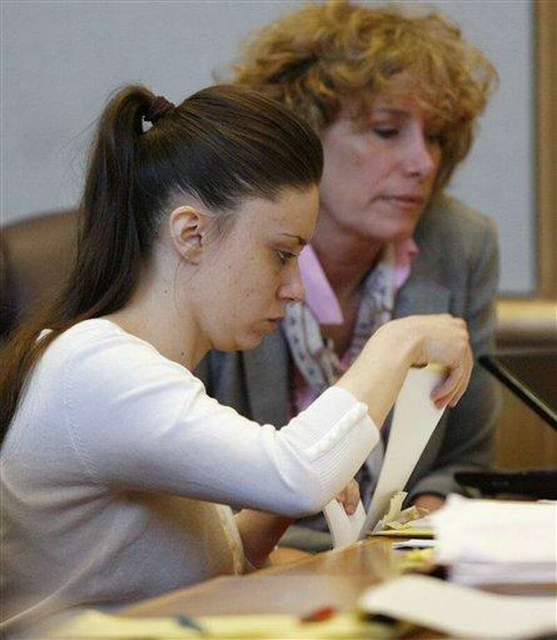 Casey Anthony, foreground, reviews case files with attorney Dorothy Clay Sims during jury selection at the Pinellas Country Criminal Justice Center in Clearwater, Fla. Anthony is accused of killing her 2-year-old daughter Caylee in 2008. (AP Photo/Gary W. Green, Pool) Photo: AP / AP2011