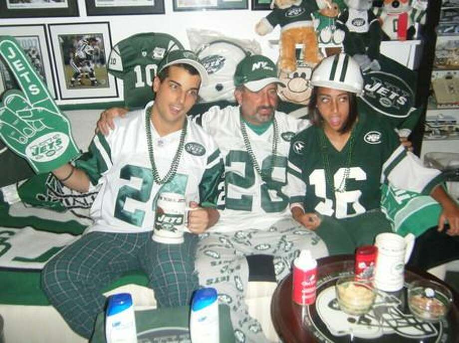 """Ricky Geremia submitted this photo of him, his father, Rick, and his sister Brittney decked out in Jets gear in the """"Jets room"""" at their home."""