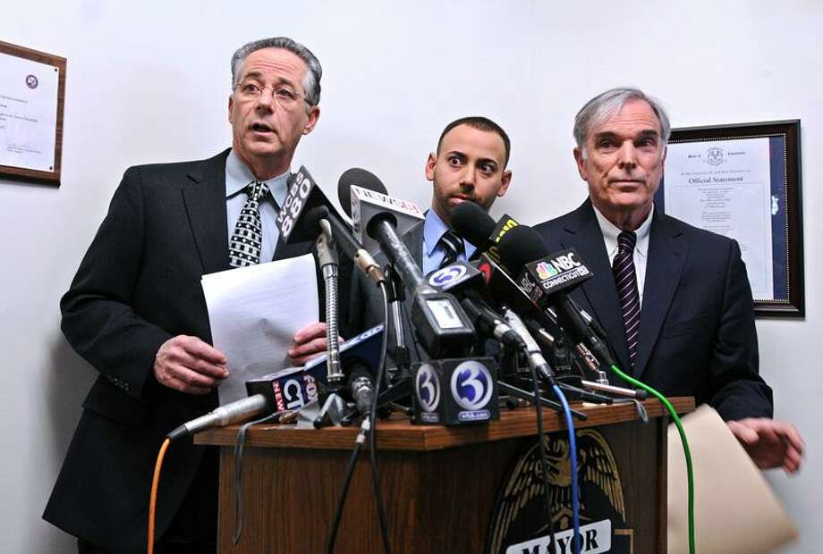 East Haven--East Haven mayor Joseph Maturo, Jr., left, along with town attorney, Joseph Zullo, center, and attorney Jonathan J. Einhorn announce the retirement of embattled East Haven police chief Leonard Gallo during a press conference at Town Hall. Einhorn is the attorney representing Gallo in his pending civil suit and will represent him if further indictments are to come from the US Attorney's office and FBI.  Peter Casolino/New Haven Register01/30/12